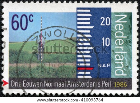 CHONGQING, CHINA - April 26, 2014: A stamp printed in Netherlands shows Surveyor with the rack in the field, circa 1986 - stock photo