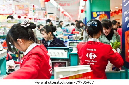 CHONGQING, CHINA - DEC 31: Carrefour counters in Chongqing on Dec 31, 2010.  The french hypermarket chain, founded in 1959, currently operates in 32 countries and has over 9,500 stores.
