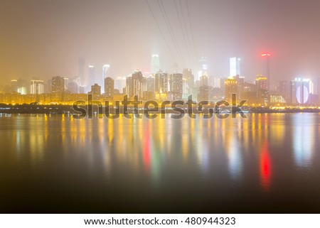 CHONGQING, CHINA - DECEMBER 29TH: This is a night view of Chongqing's financial district taken from the other side of the Yangtze river at night on december 29th, 2014 in Chongqing
