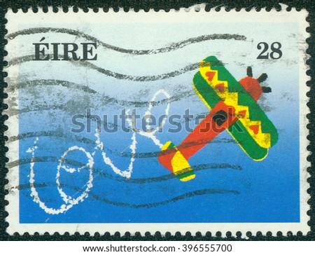 CHONGQING, CHINA - January 17, 2015: a stamp printed in Ireland shows Plane and Word Love in the Sky, circa 1994 - stock photo