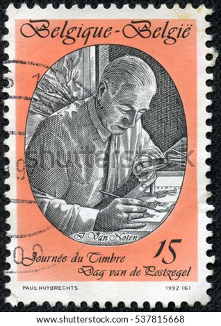 CHONGQING, CHINA - May 10, 2014:A  stamp printed by Belgium, shows Jean Van Noten, Stamp Designer, circa 1992