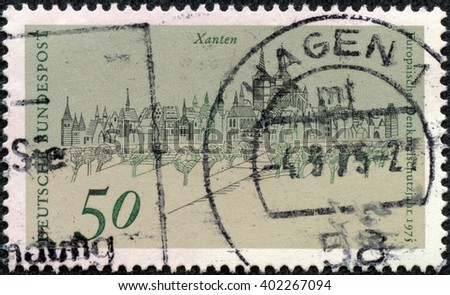 CHONGQING, CHINA - May 13, 2014:a stamp printed by Germany , shows View of Xanten, circa 1975 - stock photo