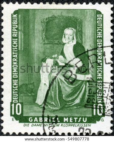 "CHONGQING, CHINA - May 11, 2014:A stamp printed in German Democratic Republic (East Germany) shows ""The Needlewoman"" (Lacemaker) by Gabriel Metsu, circa 1959"