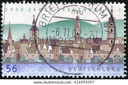 CHONGQING, CHINA - May 8, 2014:A stamp printed in Germany, shows the Town of Deggendorf, circa 2002