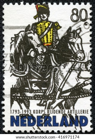 CHONGQING, CHINA - May 9, 2014: A stamp printed in Netherlands shows rider on horses on white background, 1993 - stock photo