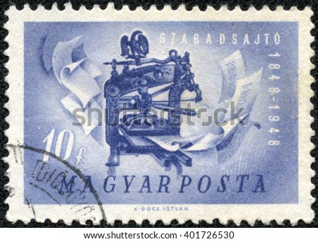 CHONGQING, CHINA - May 20, 2014:stamp printed by Hungary, shows printing press, circa 1948 - stock photo