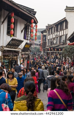Chongqing, China, 21 Nov 2012: Huge crowd in ancient city of Ciqikou with historical shophouses. - stock photo