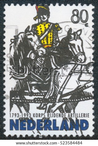 CHONGQING, CHINA - November 29, 2014:A stamp printed in Netherlands shows rider on horses on white background, 1993