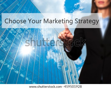 Choose Your Marketing Strategy - Businesswoman pressing modern  buttons on a virtual screen. Concept of technology and  internet. Stock Photo