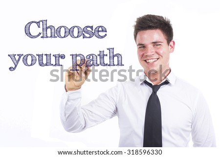 Choose your path - Young smiling businessman writing on transparent surface