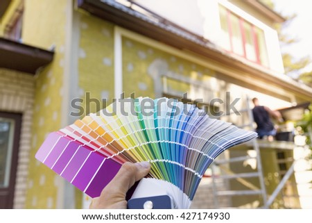 choosing a paint color for house exterior, facade - stock photo
