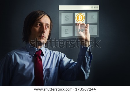 Choosing bitcoins as currency over other, businessman pressing touch screen button. - stock photo