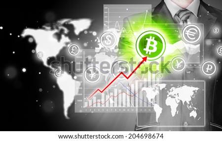 Choosing bitcoins, businessman pressing touch screen button. - stock photo