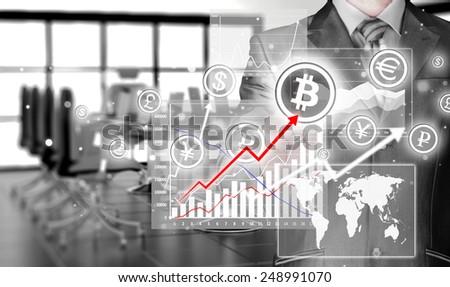 Choosing bitcoins, businessman pressing touch screen button - stock photo