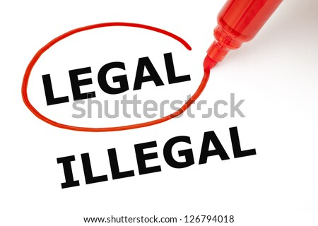 Choosing Legal instead of Illegal. Legal selected with red marker. - stock photo