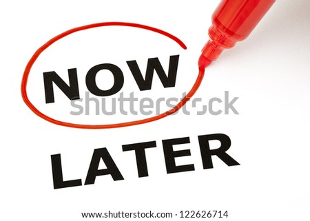 Choosing Now instead of Later, selected with red marker. - stock photo