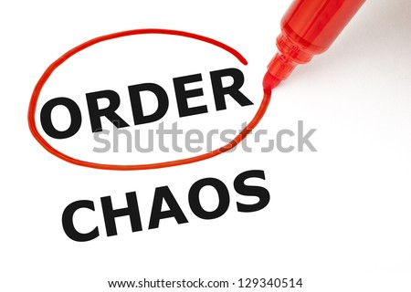 Choosing Order instead of Chaos. Order selected with red marker. - stock photo