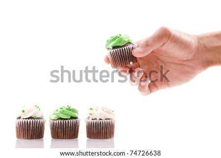 Choosing the Green Frosted Cupcake