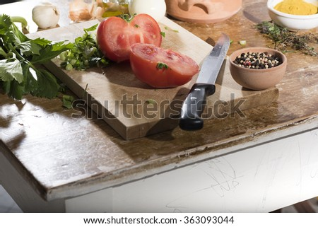 Chop celery, tomato, onions on a wooden cutting board for cooking. Italian food - stock photo