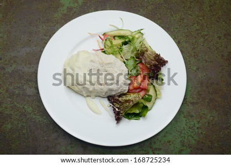 Chop chicken meat decorated with green salad