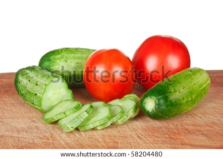 chop tomatoes and cucumbers  isolated  on white background