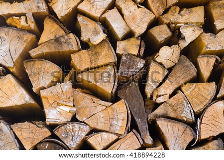 chopped and stacked in the stack of firewood for the stove - stock photo