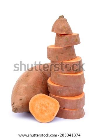 chopped and whole  sweet potato on white background - stock photo