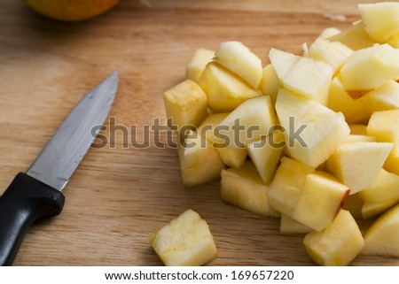 Chopped apples with paring knife ready for baking - stock photo