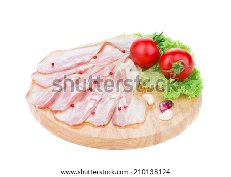 Chopped bacon on board. Isolated on a white background. - stock photo