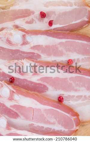 Chopped bacon on plate. Isolated as a whole background. - stock photo