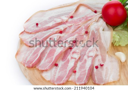Chopped bacon on plate. Isolated on a white background. - stock photo
