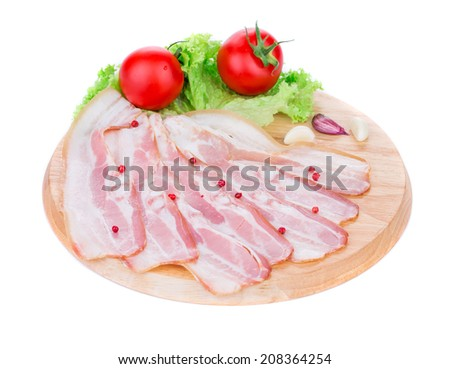 Chopped bacon on platter. Isolated on a white background. - stock photo