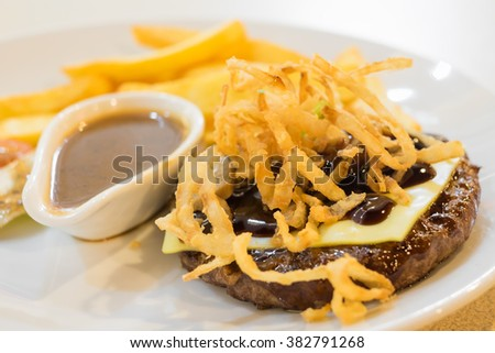 Chopped Beef Steak, Close up photo with selective focus on fried onion - stock photo