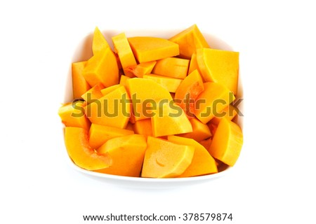 chopped butternut squash in the bowl on yellow background - stock photo