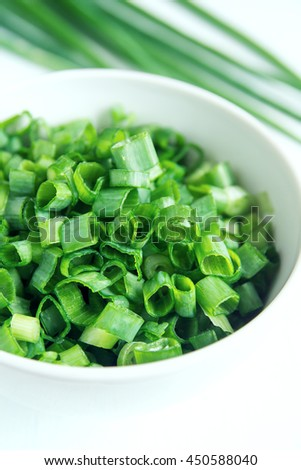 Chopped chives in white bowl, organic green ingredient for cooking - stock photo