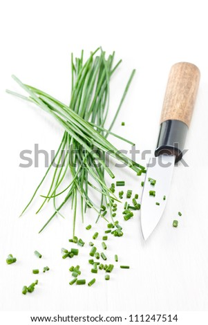 Chopped chives with japanese knife - stock photo