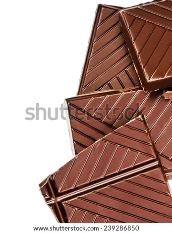 Chopped chocolate bar isolated on white background. Dark chocolate pieces closeup  - stock photo