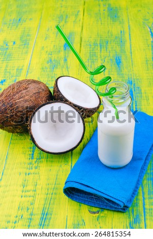 Chopped coconut with coconut milk. Milkshake. Wooden board rustic