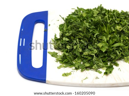 chopped dill parsley on the chopping board - stock photo