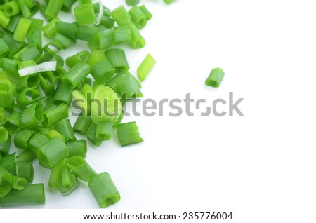 chopped fresh green spring onions isolated on white - stock photo