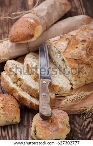 Chopped fresh homemade bread placed on a wooden table