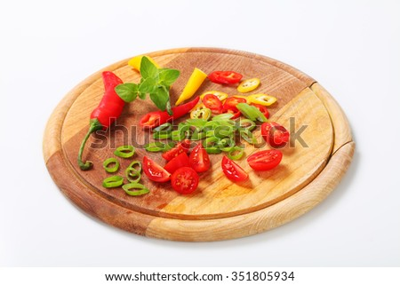 Chopped fresh vegetables on cutting board