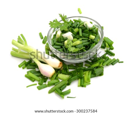 chopped green onions in glass bowl on white - stock photo