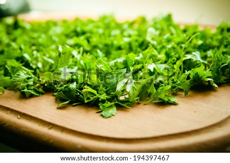 chopped greens on board