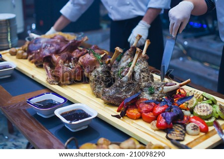 Chopped grilled roasted delicious steak meat chicken lamb pork on a plate in a restaurant - stock photo