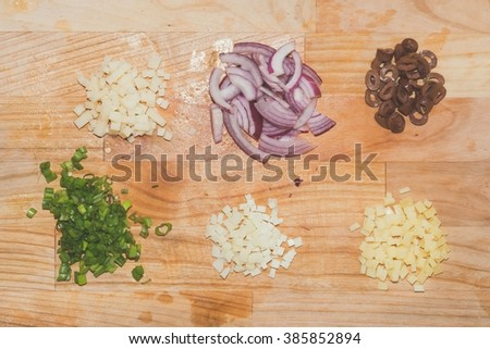 chopped ingredients. chives,Cheese, red onion, olives - stock photo