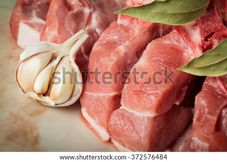 Chopped pork on a marble countertop in the kitchen - stock photo
