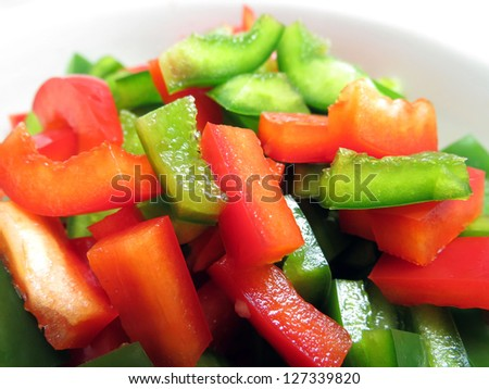 Chopped Red and Green Bell Peppers in bowl - stock photo