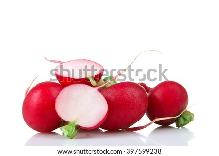 chopped red radishes bunch green tail on a white background isolated - stock photo
