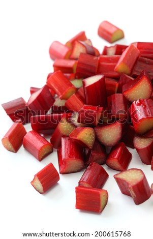 chopped red rhubarb on white background